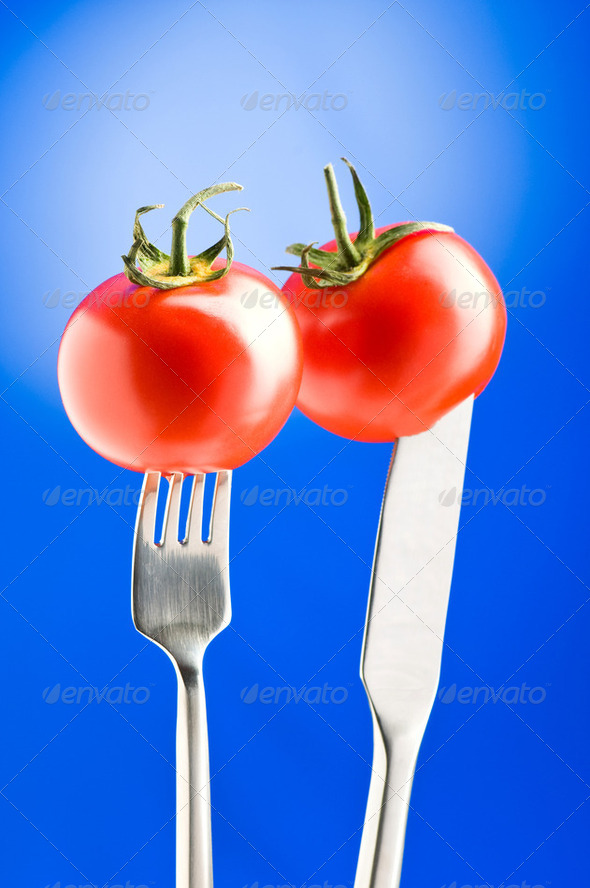 Red tomato against gradient background - Stock Photo - Images