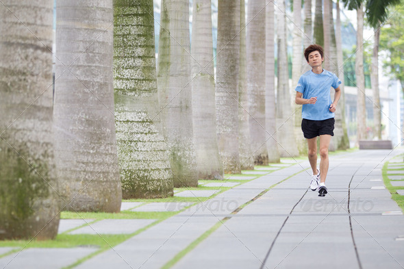Asian man jogging. - Stock Photo - Images