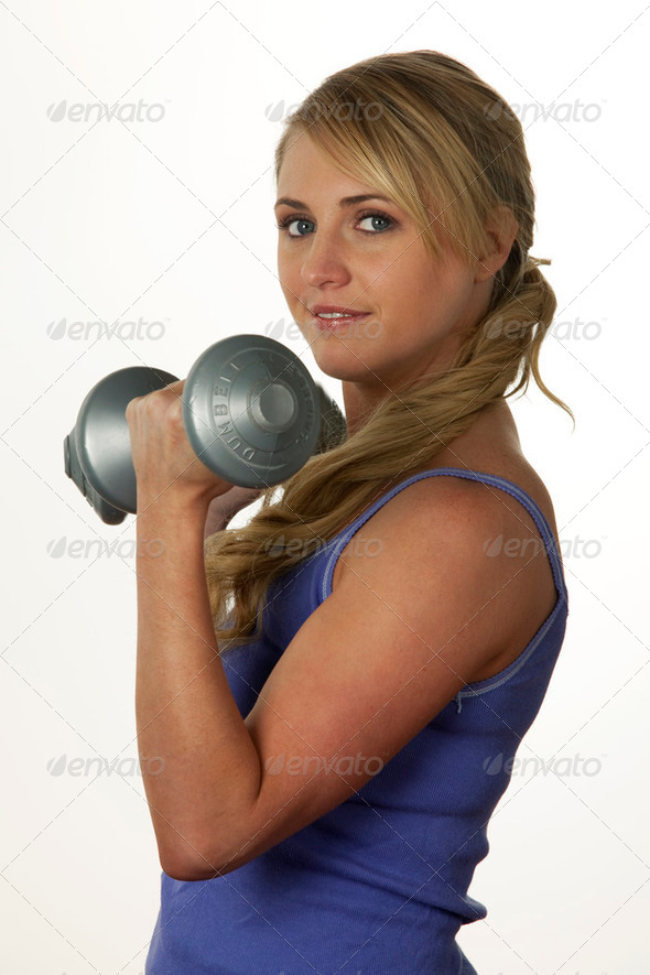 Woman using dumbbells - Stock Photo - Images