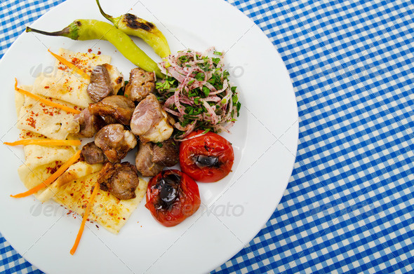 Meat cuisine - kebab served in plate - Stock Photo - Images