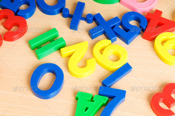 Children letters and digits on the table - Stock Photo - Images