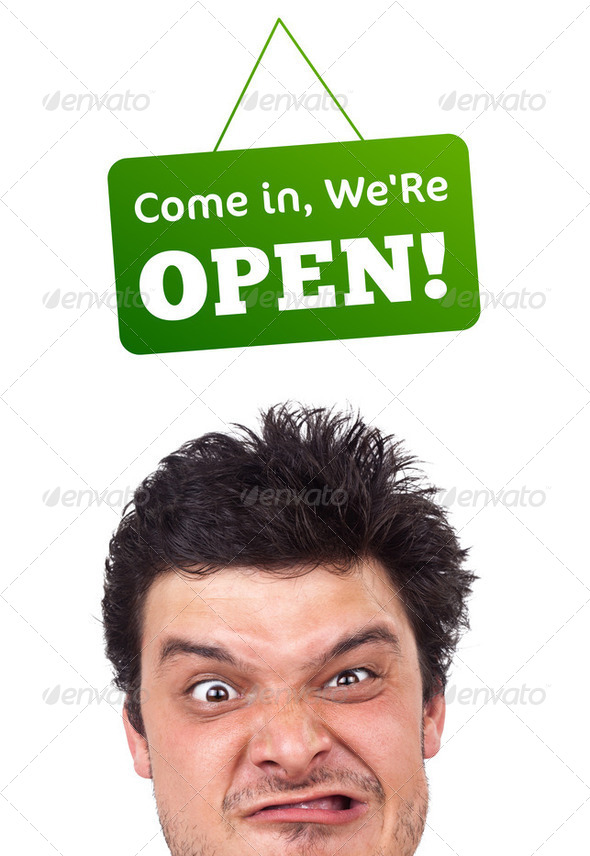 Young persons head looking at closed and open signs - Stock Photo - Images