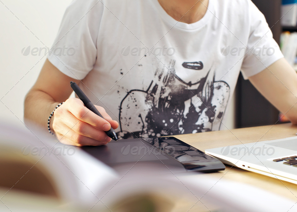 Man Using Graphics Tablet - Stock Photo - Images