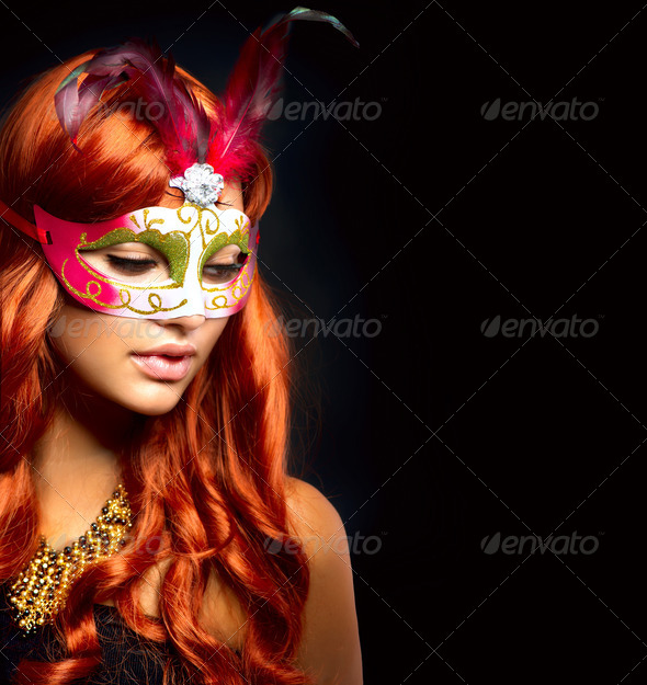 PhotoDune Beautiful Woman in a Carnival mask Isolated on Black 3321168