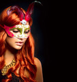 Beautiful Woman in a Carnival mask. Isolated on Black - PhotoDune Item for Sale