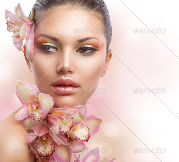 Beautiful Girl With Orchid Flowers. Perfect Make-up - Stock Photo - Images