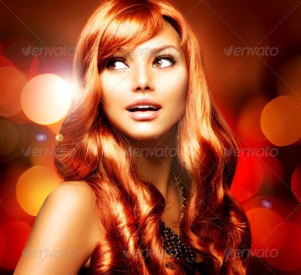 Beautiful Girl With Shiny Red Long Hair over Blinking Background - Stock Photo - Images