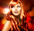 Beautiful Girl With Shiny Red Long Hair over Blinking Background - PhotoDune Item for Sale