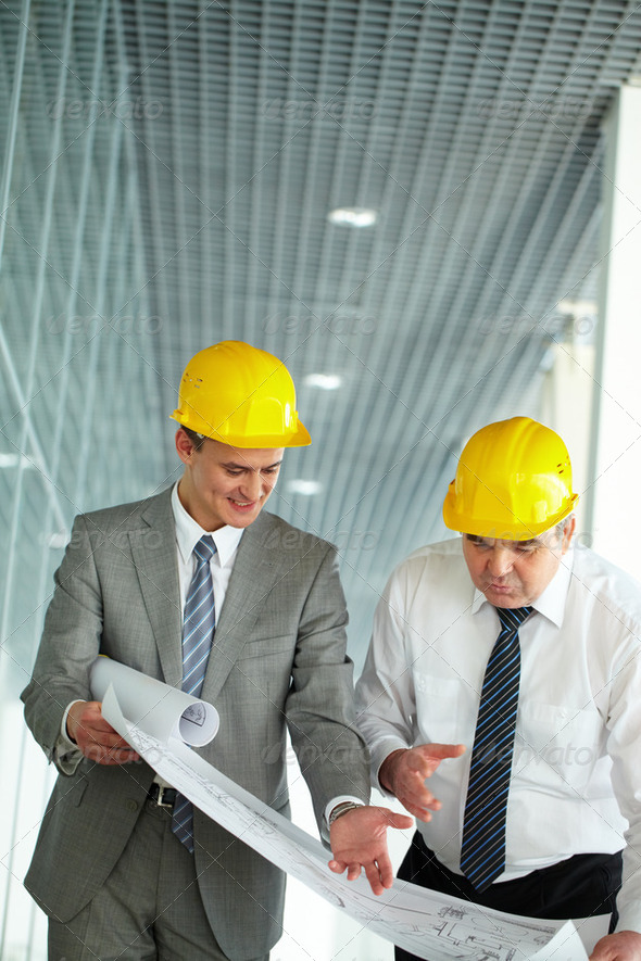 Discussing blueprint - Stock Photo - Images