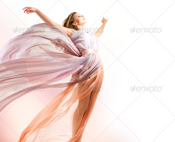 Beautiful Girl in blowing Dress Flying - Stock Photo - Images