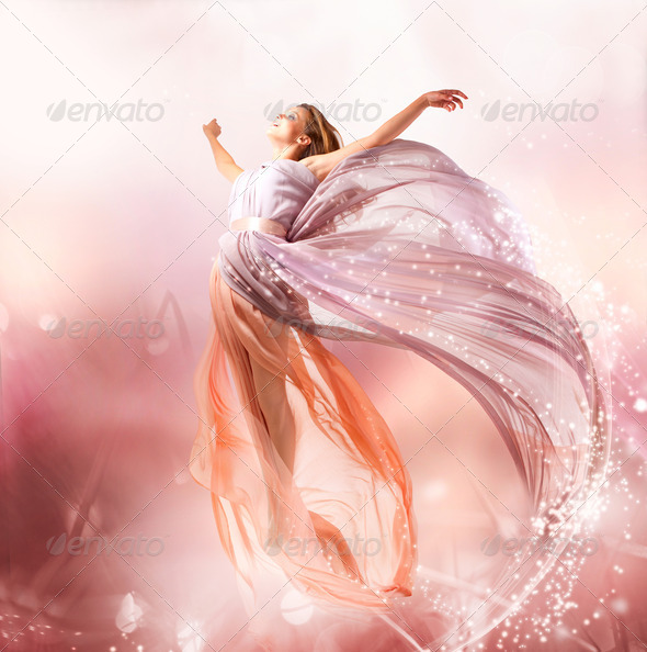 Fairy. Beautiful Girl in Blowing Dress Flying. Magic - Stock Photo - Images