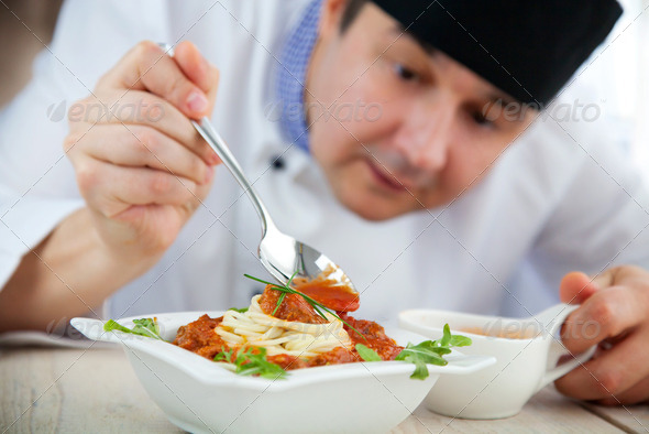 Chef with dish - Stock Photo - Images