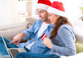 Couple with credit card buying online. Christmas Shopping - PhotoDune Item for Sale