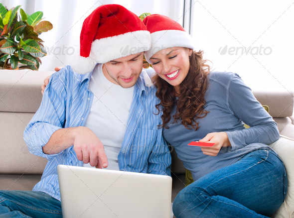 Christmas Online Shopping. Couple Using Credit Card to E-Shop - Stock Photo - Images