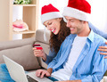 Young couple with laptop and credit card buying online - PhotoDune Item for Sale