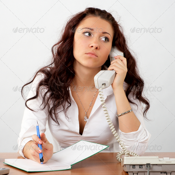 Businesswoman talking phone - Stock Photo - Images