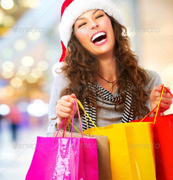 Christmas Shopping. Woman with Bags in Shopping Mall. Sales - Stock Photo - Images