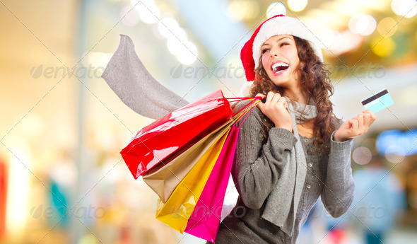 Christmas Shopping. Girl With Credit Card In Shopping Mall.Sales - Stock Photo - Images