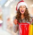Christmas Shopping. Happy Woman with Bags in Mall. Sales - PhotoDune Item for Sale