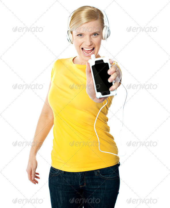 Happy glamorous lady showing her phone - Stock Photo - Images