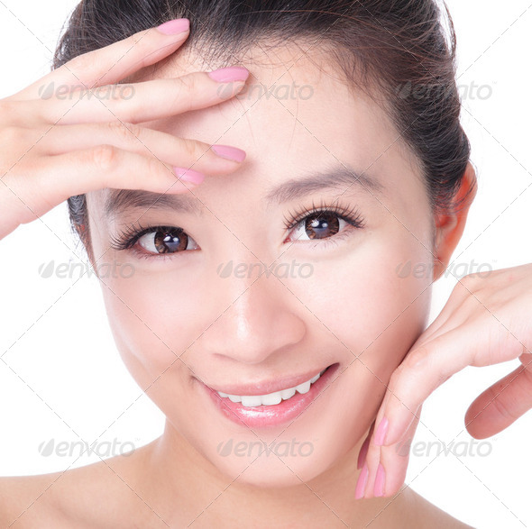 skincare woman smile and hand touch her face - Stock Photo - Images