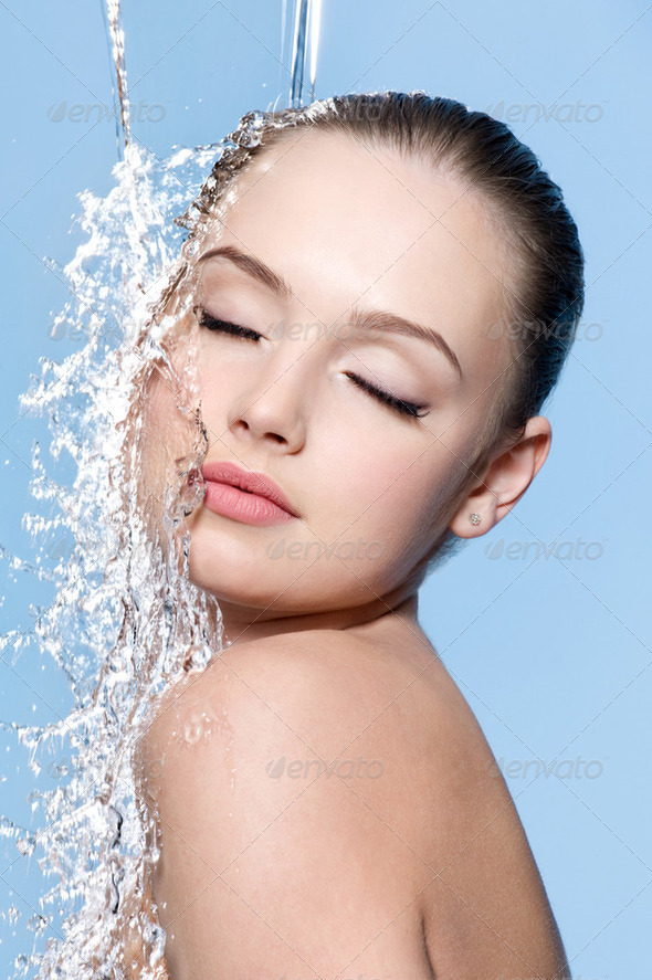 Teen under splash of water - Stock Photo - Images