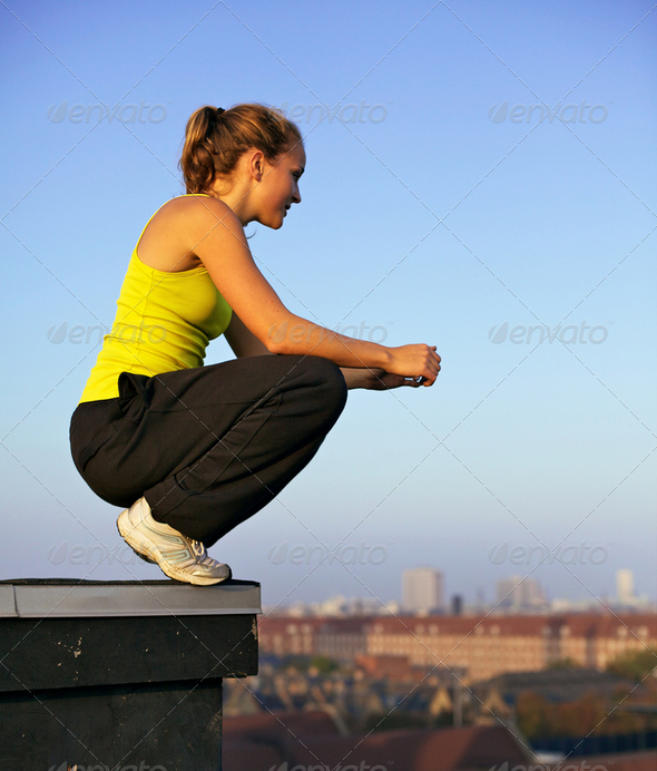 Traceur Balanced On Building Roof - Stock Photo - Images