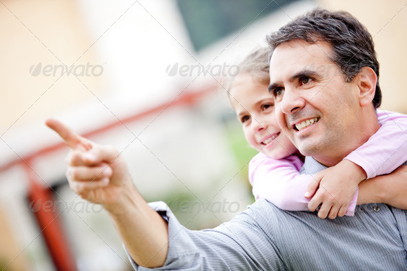 Father and girl pointing - Stock Photo - Images