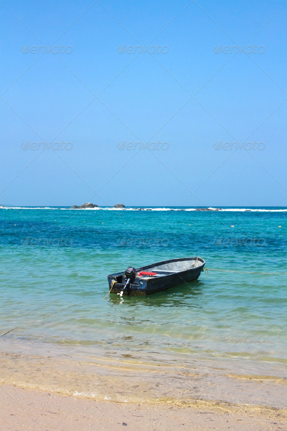 Boat in caribbean beach. Tayrona National Park. Colombia - Stock Photo - Images