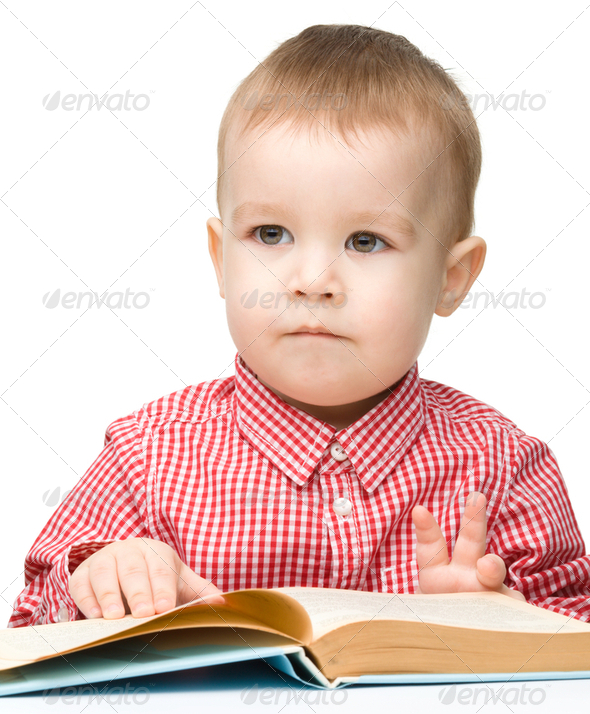 Little child play with book - Stock Photo - Images