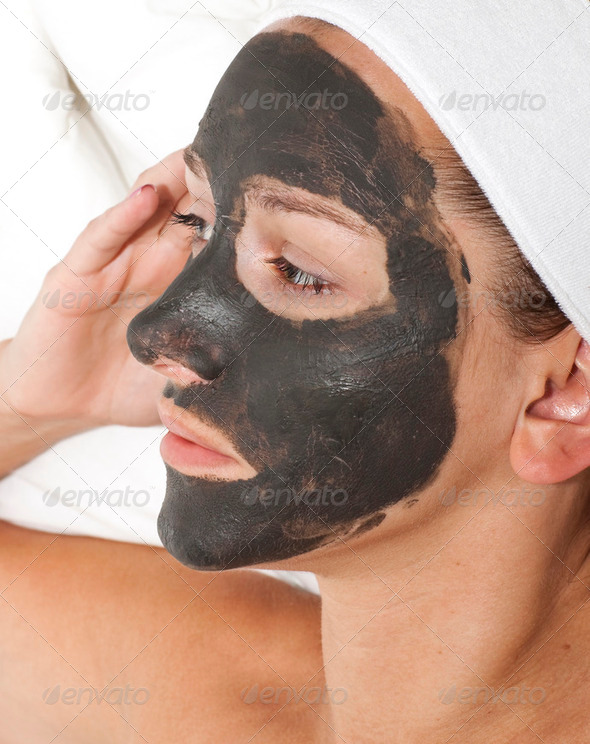 Deep sea mud mask treatment on the woman face - Stock Photo - Images