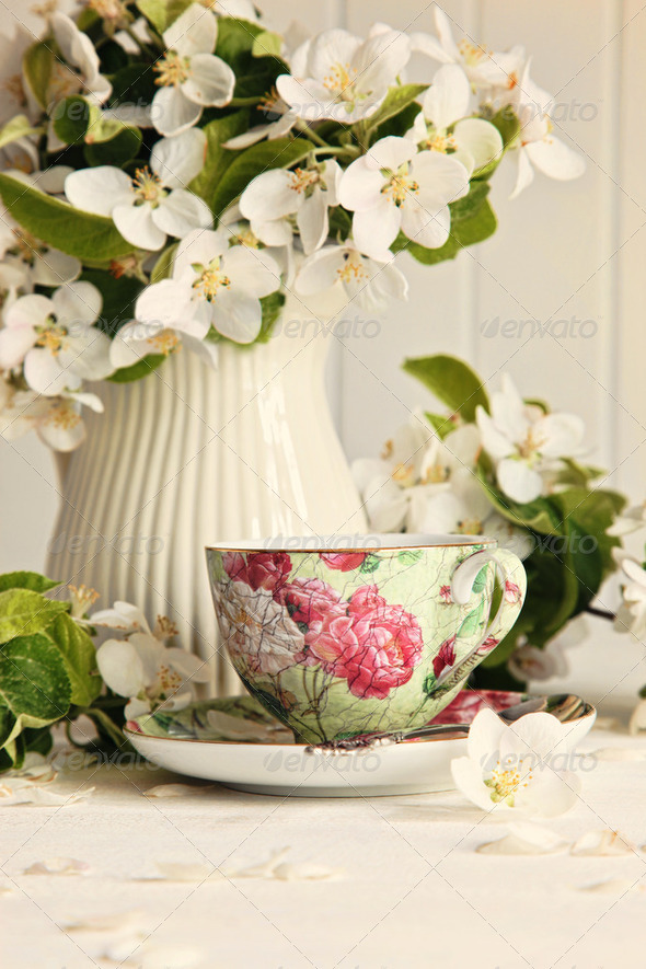 Tea cup with fresh flower blossoms - Stock Photo - Images