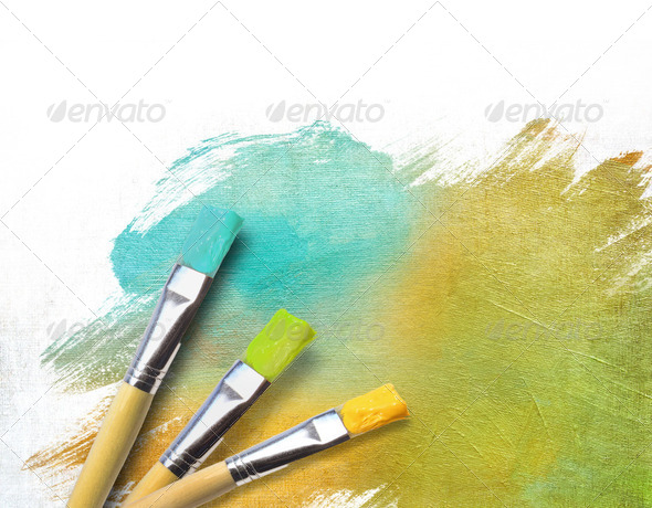 Artist brushes with a half finished painted canvas - Stock Photo - Images