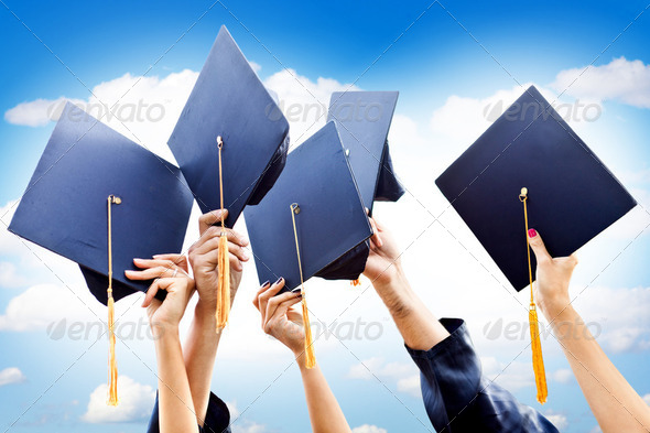 Throwing graduation hats - Stock Photo - Images