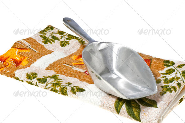 dosing scoop and kitchen towel - Stock Photo - Images
