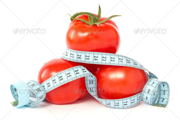 Tomatoes Wrapped With Measuring Tape - Stock Photo - Images