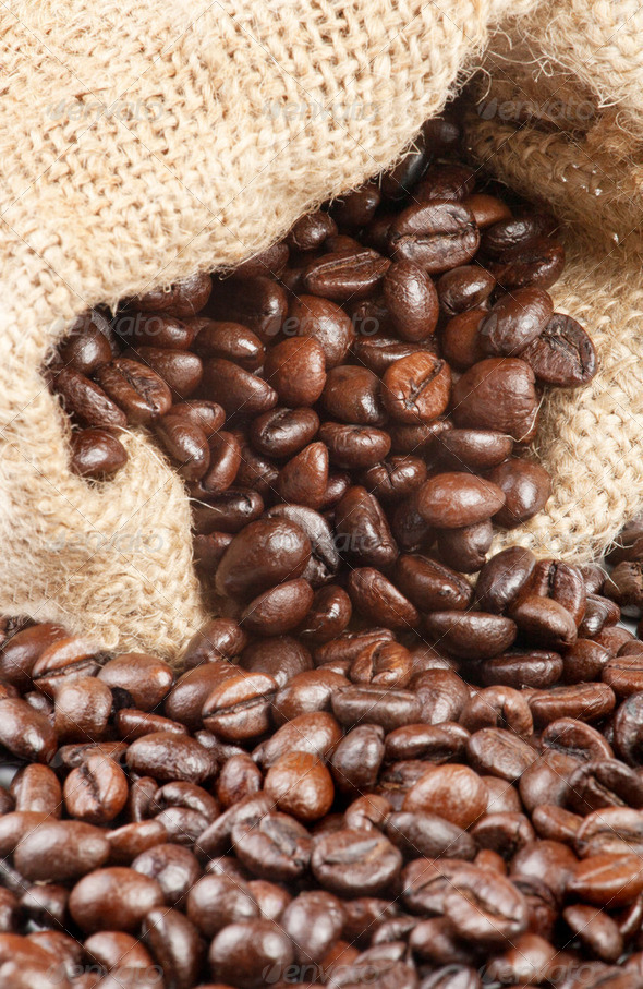 Coffee beans in a canvas sack - Stock Photo - Images