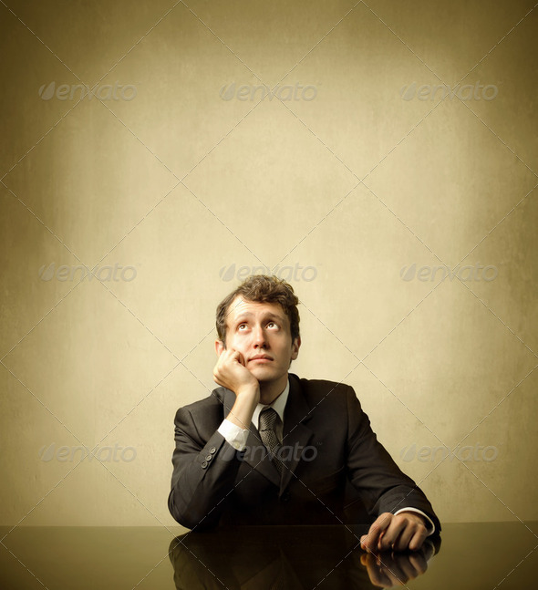 Pensive businessman - Stock Photo - Images