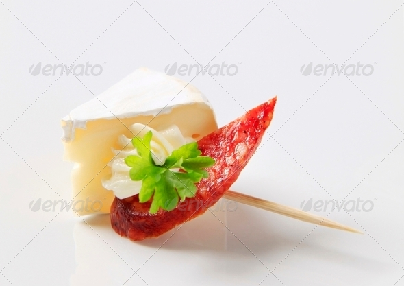 Cheese and salami on a stick - Stock Photo - Images