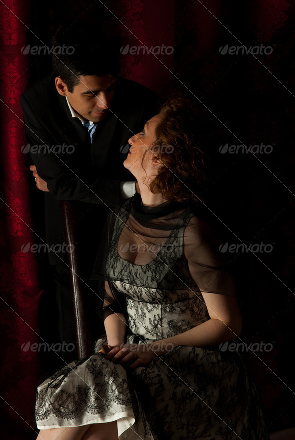 Elegant couple having conversation - Stock Photo - Images