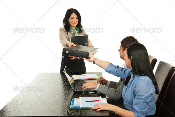 Manager giving folders employees - Stock Photo - Images