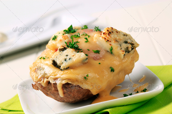 Double cheese twice baked potato - Stock Photo - Images