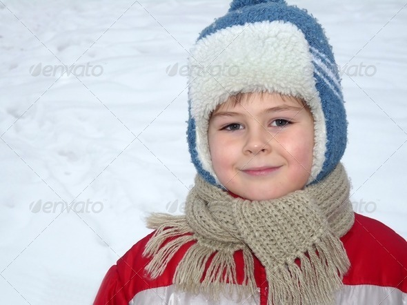 A boy in winter clothes - Stock Photo - Images
