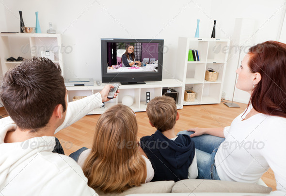 PhotoDune Young family watching TV at home 2264578