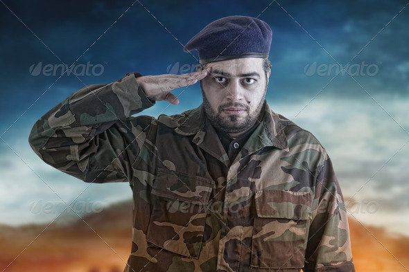 Soldier Salutes ready to serve and sacrifice for his country - Stock Photo - Images