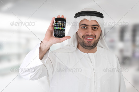 Arabian business man in office with mobile - Stock Photo - Images