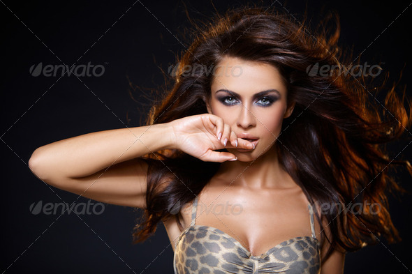 Portrait of beautiful young woman - Stock Photo - Images