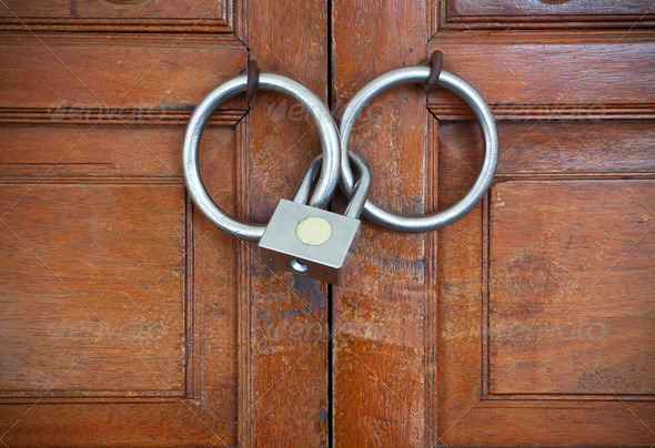 Closed wooden door with metal lock - Stock Photo - Images