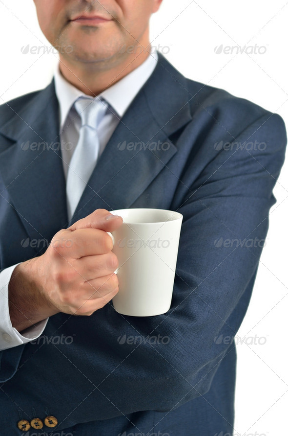 Businessman holding a cup of tea isolated on white - Stock Photo - Images
