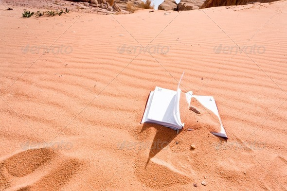 notebook in red sand dune of dessert - Stock Photo - Images